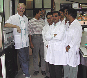 John Mekalanos next to Dr. Shah Faruque, his collaborator on cholera studies at the International Center for Diarrhea Disease Research, Dhaka, Bangladesh and other members of his research group.