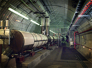 Brookhaven National Laboratory's Relativistic Heavy Ion Collider (RHIC) is really two accelerators in one — made of crisscrossing rings of superconducting magnets, enclosed in a tunnel 2.4 miles in circumference. In the two rings, beams of heavy ions are accelerated to nearly the speed of light in opposite directions, held in their orbits by powerful magnetic fields. Shown here is an area near the BRAHMS experiment.