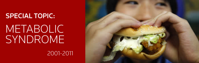 A boy poses with a chicken burger at a fast food outlet in Taipei January 29, 2010. The Taiwan Department of Health on Thursday proposed a ban on junk food advertisements aired around children's television programmes, to tackle the growing child obesity rate. REUTERS/Nicky Loh.