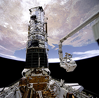 The Hubble Space Telescope stands tall in the cargo bay of the space shuttle Atlantis following its capture on Wednesday, May 13, 2009. Photo from NASA, and HUBBLESITE. NASA Images: http://www.nasaimages.org/index.html. HUBBLESITE: http://hubblesite.org/gallery/spacecraft/05/.