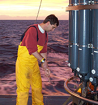 Click to enlarge. Scott Doney collecting a water sample on the NOAA R/V Ronald H. Brown in the South Atlantic as part of a global survey of ocean carbon distributions.