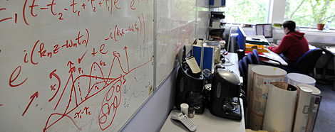 Calculations are seen on a white board in a laboratory at Imperial College in London, May 28, 2010, REUTERS/Paul Hackett