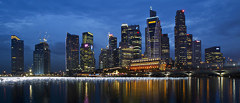 Singapore's central business district is pictured at dusk, December 30, 2009. REUTERS/Tim Chong.