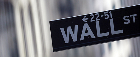 A street sign is seen outside the New York Stock Exchange in New York, New York. REUTERS/Eric Thayer.